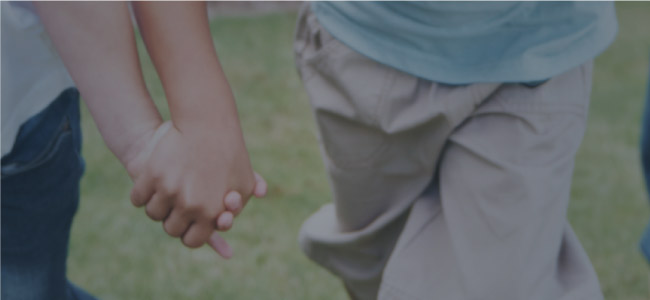 photo image of two people holding hands