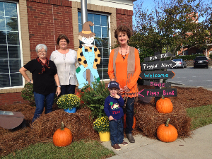 Vienna Branch employees posed outside with their fall decor.
